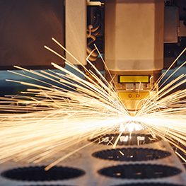 Laser cutting technology of flat sheet metal steel material processing with sparks.
